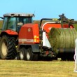 Farmer baling the harvested crop — Stock Video