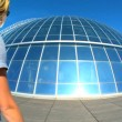 Female visitor at  the dome of solar panels at Pearl Museum, Iceland - Stock Photo