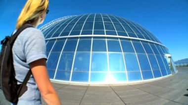 Female visitor at the dome of solar panels at Pearl Museum, Iceland — Stock Video