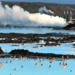 Steam for geothermal energy being piped from natural volcanic hot springs to power plant — Stock Video #20394129