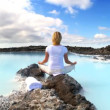 Stock Video: Lone female using relaxation therapy with geothermal hot springs in foreground