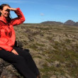Lone female hiker outdoors in barren landscape — Stock Video