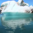 Glacial iceberg slowly melting into the lake through global warming — 图库视频影像
