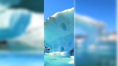 Moving graphics of melting icebergs on a seamless loop to depict climate change — Stock Video