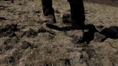 Feet of hiker walking outdoors over rough uneven terrain — Stock Video