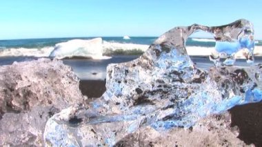 Melting glacial ice from climate change washed up on an arctic beach — Stock Video #20465309