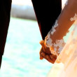 Young couple holding hands after their beach wedding-close-up — Stock Video