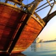 Traditional wooden fishing dhow at anchor - Stock Photo