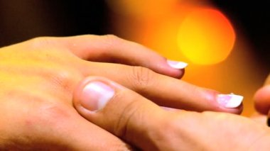 Diamond ring being placed on female finger during marriage proposal in close-up — Stock Video #20831391