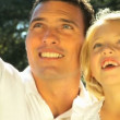 Stock Video: Young father tenderly holding his daughter while outdoors on summers day