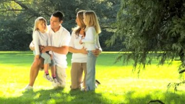 Portrait of young caucasian family enjoying time out together on a summers day — Stock Video