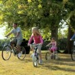 Young caucasian family enjoying cycling together on a summers day — Stock Video