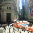 Time-lapse shot wide fish-eye of buildings & pedestrins on Wall St, USA - Stock Photo