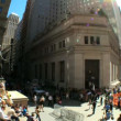 Fish-eye view of commuters,pedestrians &amp; buildings on Wall ST, USA - Photo