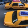 Fish-eye view of yellow taxi cabs in New York City, USA negotiating the busy streets - Stock Photo