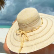 Elegant young female relaxing on white sandy beach looking at aquamarine waters — Stock Video