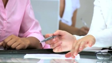 Hands only of multiethnic businesswomen signing papers in a modern office — Stock Video