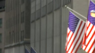 Motion jib shot of street sign & American flags on Wall Street, New York City, USA — Stock Video