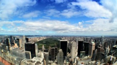 Time-lapse aerial shot of Central Park surrounded by skyscrapers in New York City — Stock Video