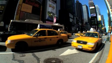 Fish-eye view of a fleet of yellow taxi cabs on Times Square, New York City — Stock Video