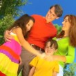 Attractive young caucasian family enjoying spending leisure time together outdoors — Stock Video