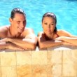 Young caucasian couple enjoying leisure time together in their swimming pool — Stock Video