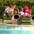 Attractive young caucasian family enjoying  leisure time together outdoors in their garden — Stock Video