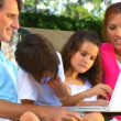 Attractive young caucasian family using a laptop outdoors to make future plans — Stockvideo