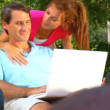 Stock Video: Attractive young heterosexual couple using laptop outdoors to make future plans