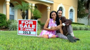 Excited young african american couple celebrate buying their new home — Stock Video
