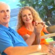 Contented retired couple enjoying a healthy outdoor breakfast lifestyle — Stock Video
