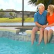 Contented retired couple enjoying a healthy outdoor lifestyle — Stock Video