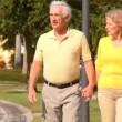 Stock Video: Contented retired couple enjoying healthy outdoor lifestyle out walking