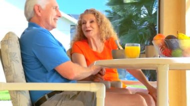 Contented retired couple enjoying a healthy outdoor breakfast  lifestyle
