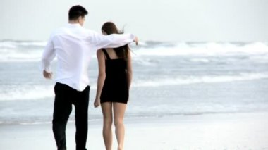 Two young in love walking on the beach after a social night out — Stock Video