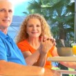 Contented retired couple enjoying healthy outdoor breakfast lifestyle — Stock Video #21045325