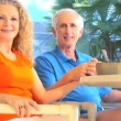 Contented retired couple enjoying a healthy outdoor breakfast lifestyle — Stock Video #21045339