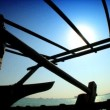 Middle-eastern fisherman in silhouette on his traditional wooden dhow — Wideo stockowe