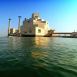 Stock Video: Building housing Islamic Museum seen from water