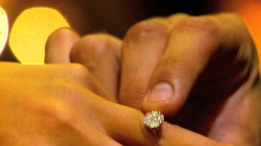 Diamond ring being placed on female finger during marriage proposal in close-up — Stock Video