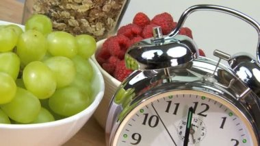 Clock hands symbolizing the need to make time for a healthy breakfast in a busy modern lifestyle