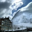 Stock Video: Time-lapse Clouds over Swiss Resort with Eiger Behind