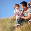 Male Family Fun Outdoors - Stock Photo