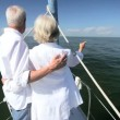 Mature Couple on Luxury Yacht - Stock Photo