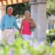 Retired Couple Arriving at Shopping Mall - Stock Photo