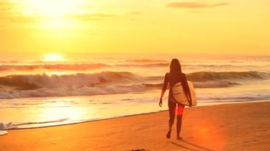 Young Surf Girl at Sunrise — Stock Video