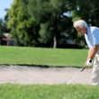 Senior Gentleman Playing Golf - Stock Photo