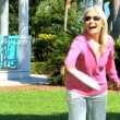 Mature Lady Fun in the Park - Stock Photo
