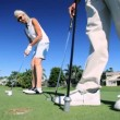 Enjoying Retirement Playing Golf - ストック写真