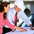Architect & Client Discussing Designs - Stock Photo